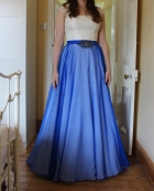 Royal blue silk chiffon over skirt being checked during the final fitting